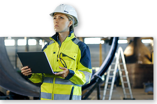 Worker with laptop inspecting